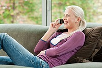 Young woman on cell phone at home