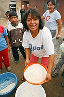 Woman with pan of rice, Lima, Peru
