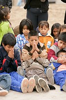 Young children praying, Lima, Peru