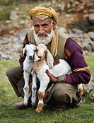 Senior male with young goats