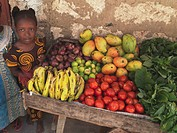 Girl with a cart of fresh produce in Kenya, Africa