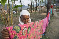 Elderly woman hanging clothes, Pokhara, Chitwan, Nepal