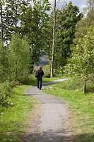 Woman walking on a path