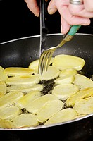 Stock photo of potatoes frying in a pan