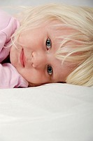 Stock photo of a portrait of a blond haried blue eyed three year old child