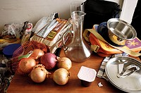 Canada, Ontario. Windsor. Onions, pots, decanter and bread on messy countertop