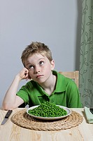 Boy with plate of peas