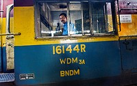 An Indian locomotive with its driver