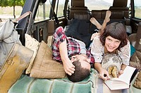 Couple relaxing in back of suv