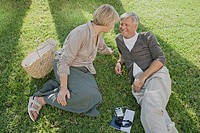 Man and woman relaxing on grass