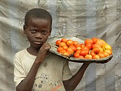 Street vendor, boy, Mozambique