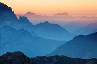 View over mountaintops at dusk from Mangrt Pass looking from Slovenia towards Italy at sunset, Triglavski National Park, Julian Alps, Slovenia, Europe