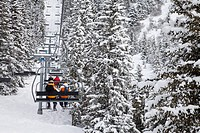 Skiers on a chairlift, Meribel ski resort in the Three Valleys Les Trois Vallees, Savoie, French Alps, France, Europe