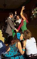 Feria de Abril The April Fair  ´El Real´  Women dancing at a traditional pavillion called Caseta  Seville, Andalusia, Spain