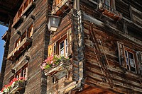 Housefront of traditional wooden house decorated with old skis in the Alpine village Grimentz, Valais, Switzerland