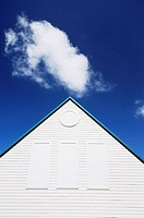 Cloud and wooden building with pitched roof