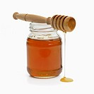 Jar of honey with drizzler