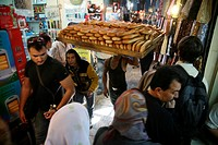 A man carries traditional bread through a market in the old city section of Jerusalem