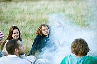 A group of young friends having a barbecue