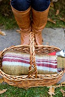 Close_up of a young woman´s feet and wicker basket