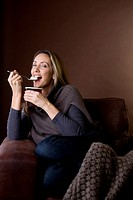 A mid adult woman eating ice cream (thumbnail)