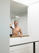 Bare_chested Man With Towel in Modern House