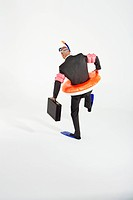 Middle_aged businessman in flippers inflatable rubber ring snorkel and goggles waddling carrying briefcase back view