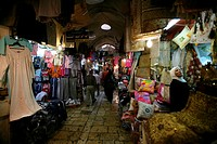 A woman browses at a market in the old city section of Jerusalem