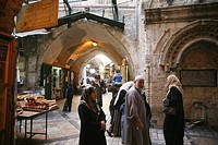 Shoppers browse at a market in the old city section of Jerusalem