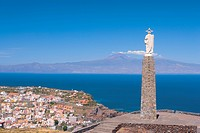 Spain _ Canary Islands _ La Gomera _ San Sebastian de La Gomera _ View of the monument al Sagrado Corazon de Jesus _ View of the Island of Tenerife an...