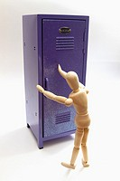 A wood manikin figure closes the door of a purple locker