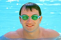 Man with swimming goggles in the pool