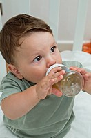 Baby boy drinking from bottle (thumbnail)