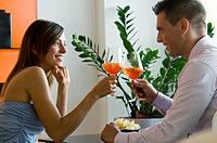 Couple toasting with orange wine (thumbnail)