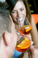 Couple drinking orange wine