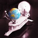 Close_up of a model depicting lunar and solar eclipses