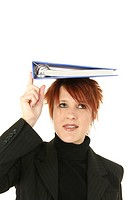 Businesswoman balancing a notebook on her head
