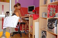 Teenage girl using a computer