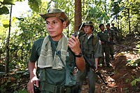A KNLA soldier listening to a radio device near the border with Thailand  In Myanmar Burma, thousands of people have settled near the border as a resu...