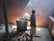 Woman boiling water at an MSF feeding centre  Feeding centres and other humanitarian aid were organised in Angola after widescale malnutrition during ...