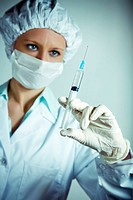 healthcare and medicine: nurse using a syringe