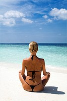 tropical beach: perfect girl meditating on a tropical beach. Copy space