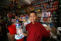 A young monk with a bottle of water in a store  Buddhist monks are living in monastries in and around Kathmandu  Many are illegal refugees from Tibet ...