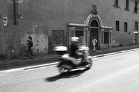 Scooter speeding down the streets of Florence, Italy. Apart from cars the scooter is the most common means of transport in most Italian cities. Shot i...