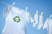 T_shirt with recycle logo drying on clothesline on a summer day