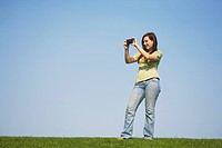 a girl taking a picture with her camera