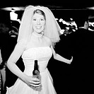 Portrait of a bride holding a beer bottle