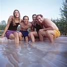 Friends Sitting In An Outdoor Hot Tub