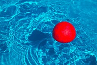 Red Ball Floating In A Swimming Pool