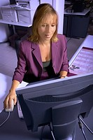 Woman Using Computer In An Office